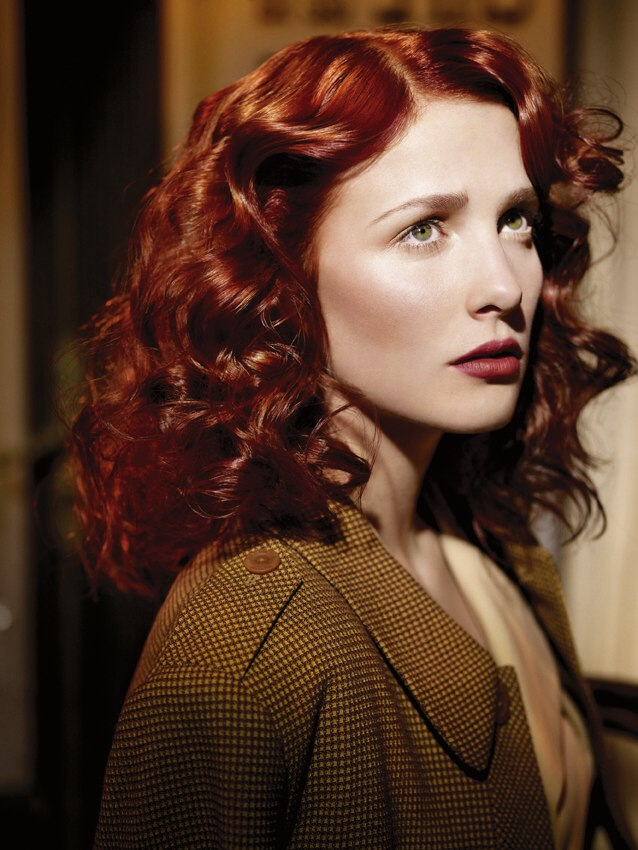 Postwar 40s vintage hairstyle for long red hair with curls and waves