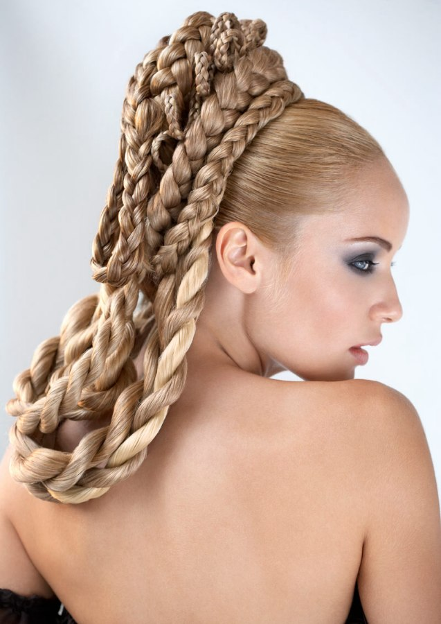 Layered braids of all sizes wrapped in loops around the back of the head