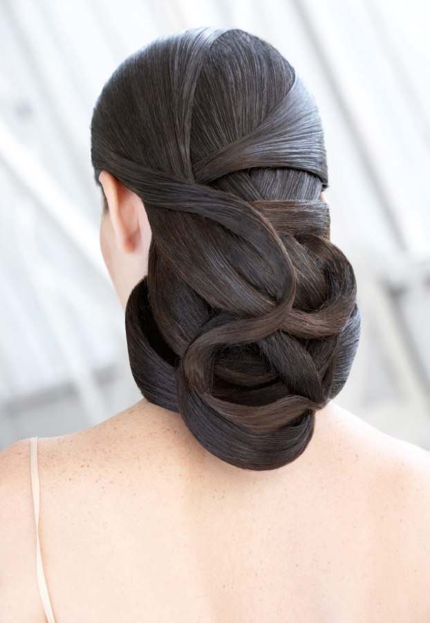 Hairstyle with strands of hair wrapped around and on top of each other