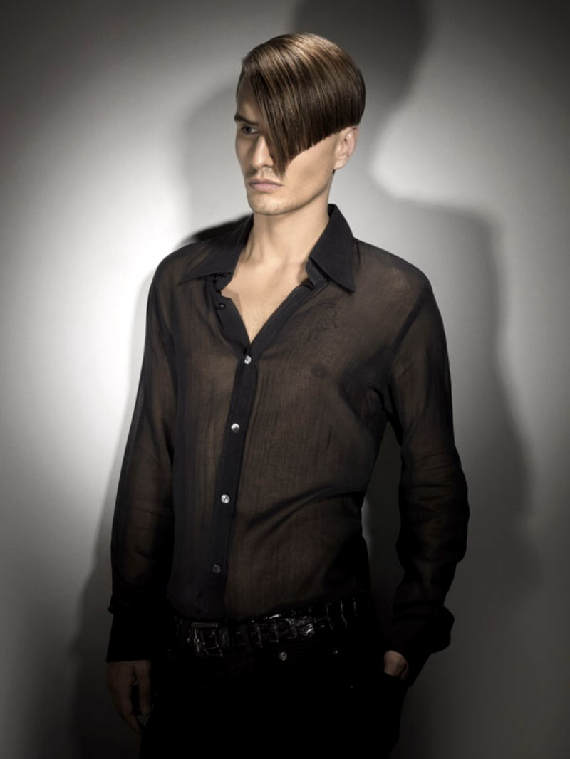 Sophisticated mens hairstyle with a closely clipped nape and tight sides