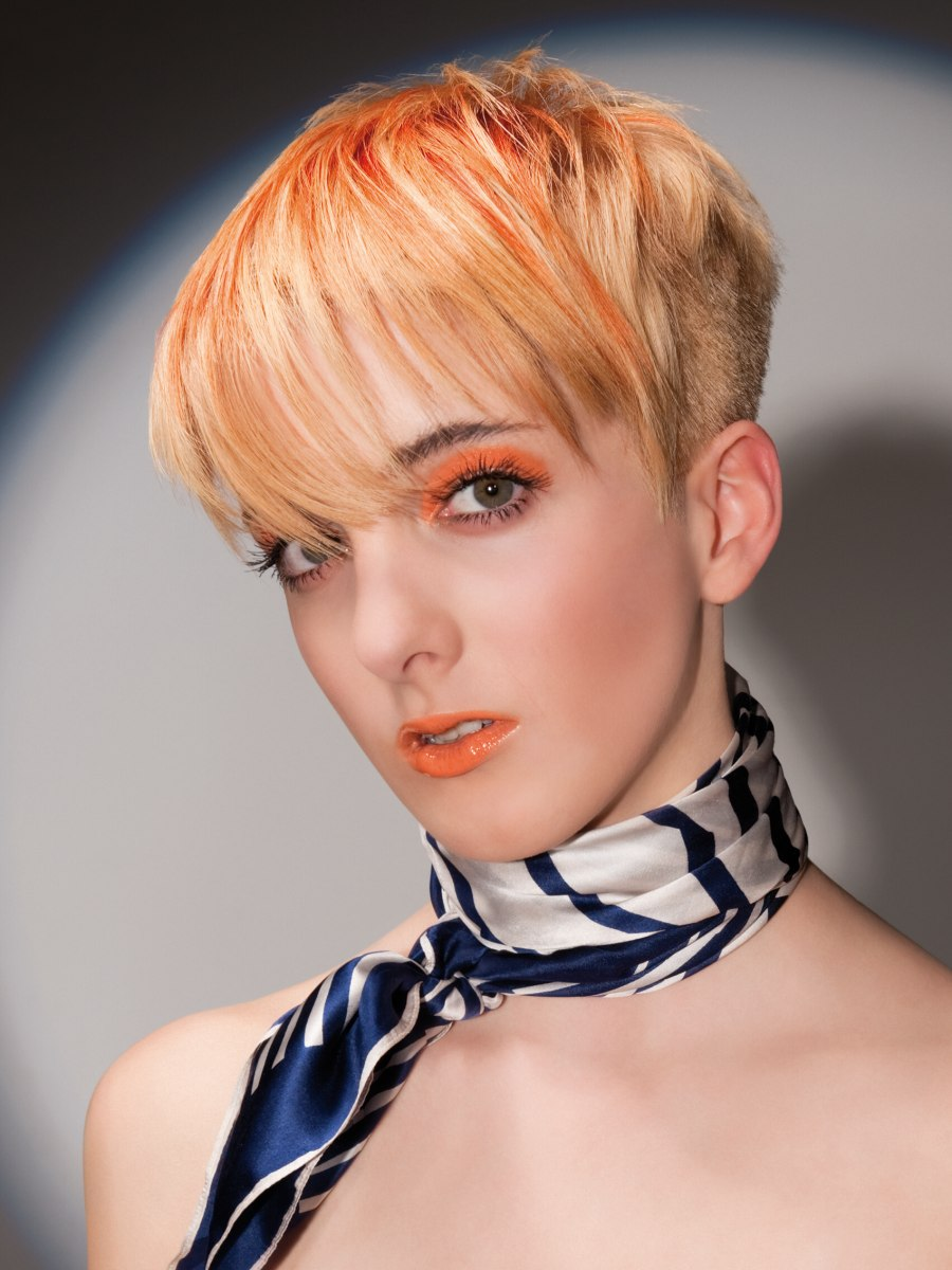 Blonde with orange hair with short clipped sides and back
