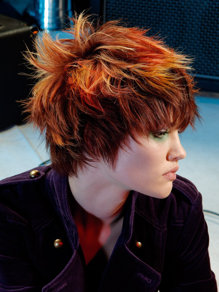 Ruffled and fringy punk hairstyle with spiky texture and color transition