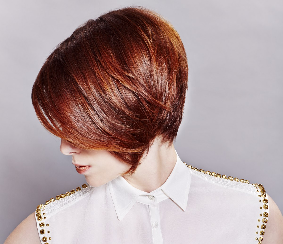 Classy short hairstyle with a round back and a dark red