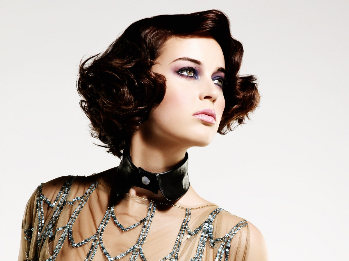Short Haircut With Curls And Waves Draped Around The Face
