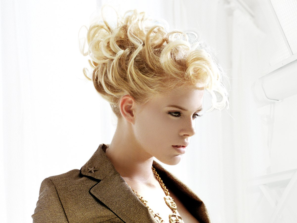 Extravagant updo with curls and all hair away from the face