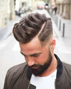 fade hairstyle with bomber jacket look