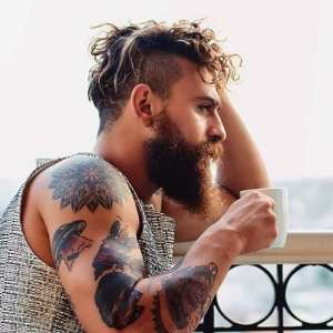 men-with-curly-undercut-hairstyle-with-beard