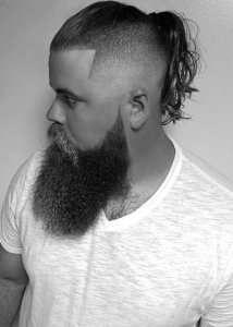 Fade Haircut With Ponytail For Men