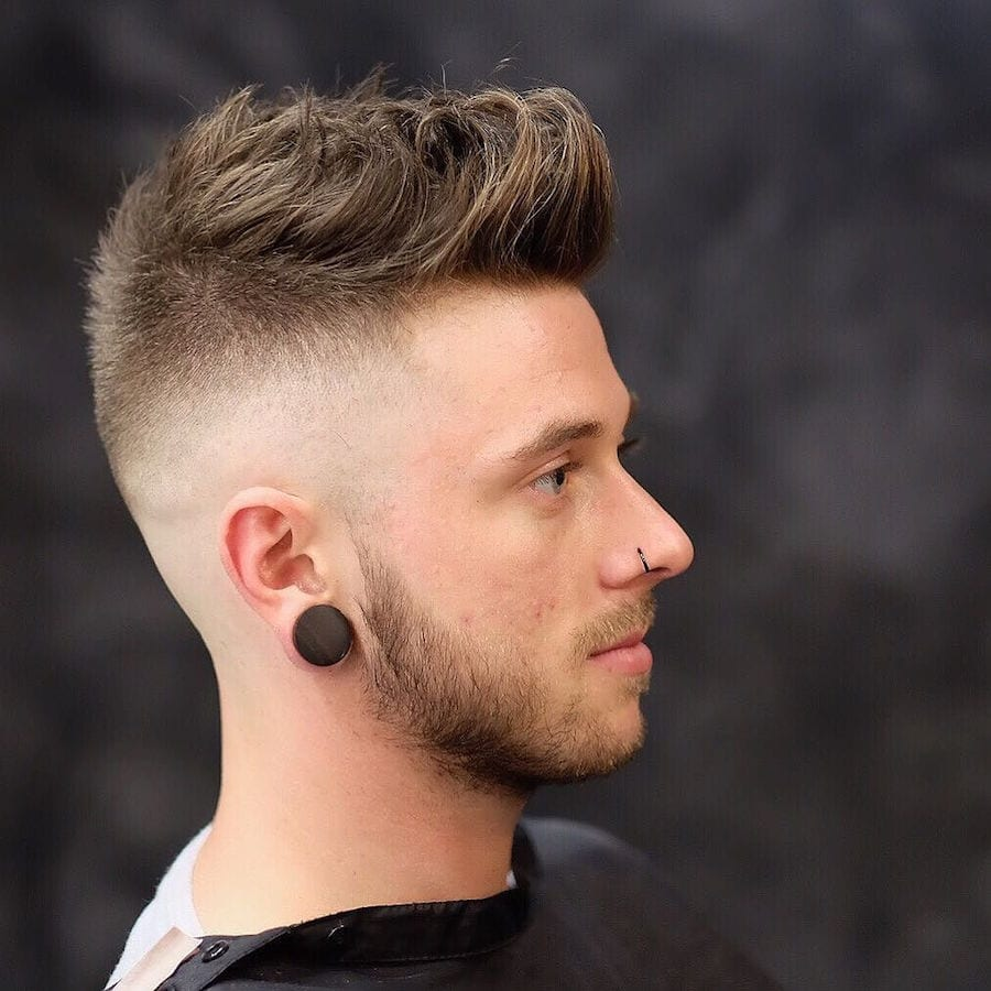 mid to high skin fade longer textures on top haircut