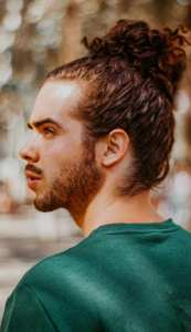 Sexy Curly hair Manbun Hairstyle for men