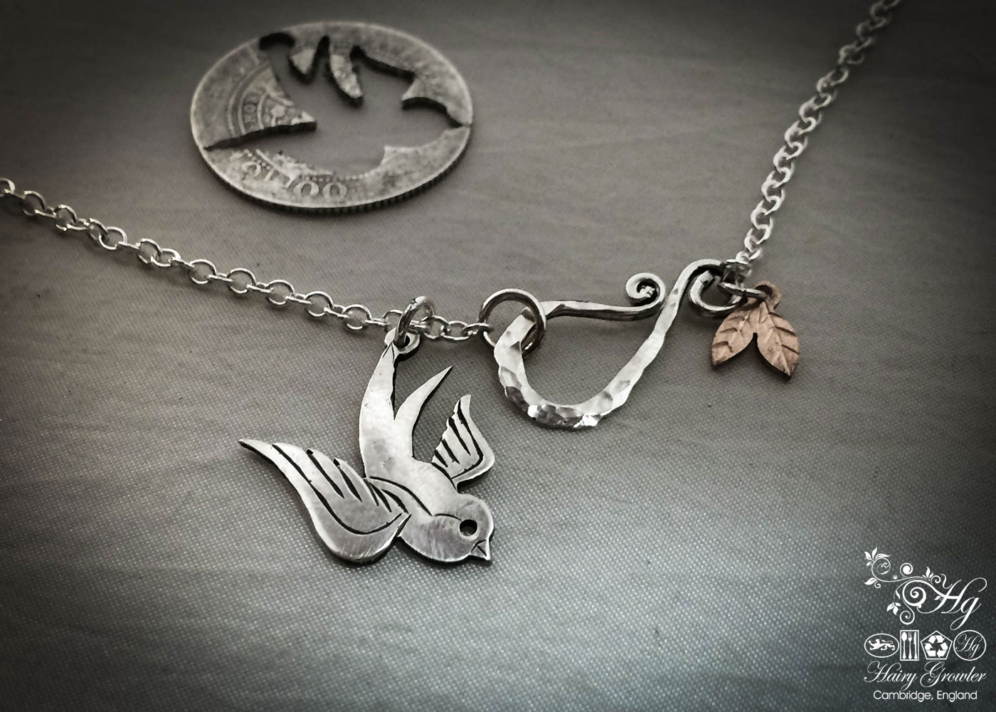 handmade and recycled silver coin swallow necklace pendant