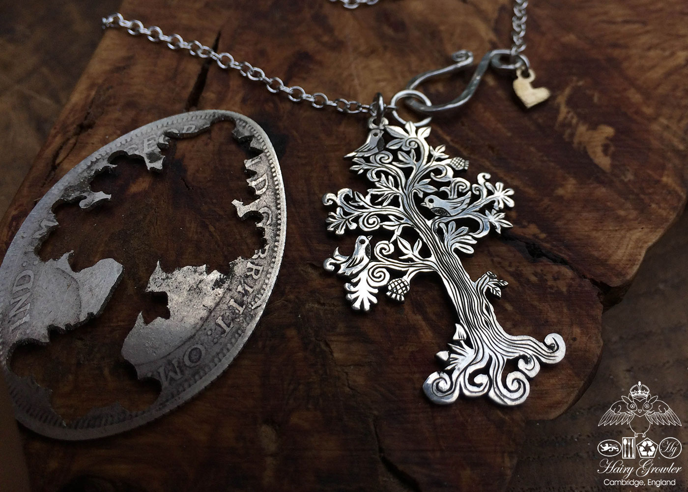 Handcrafted and recycled silver Summer tree and tweeting birds made from a silver coin