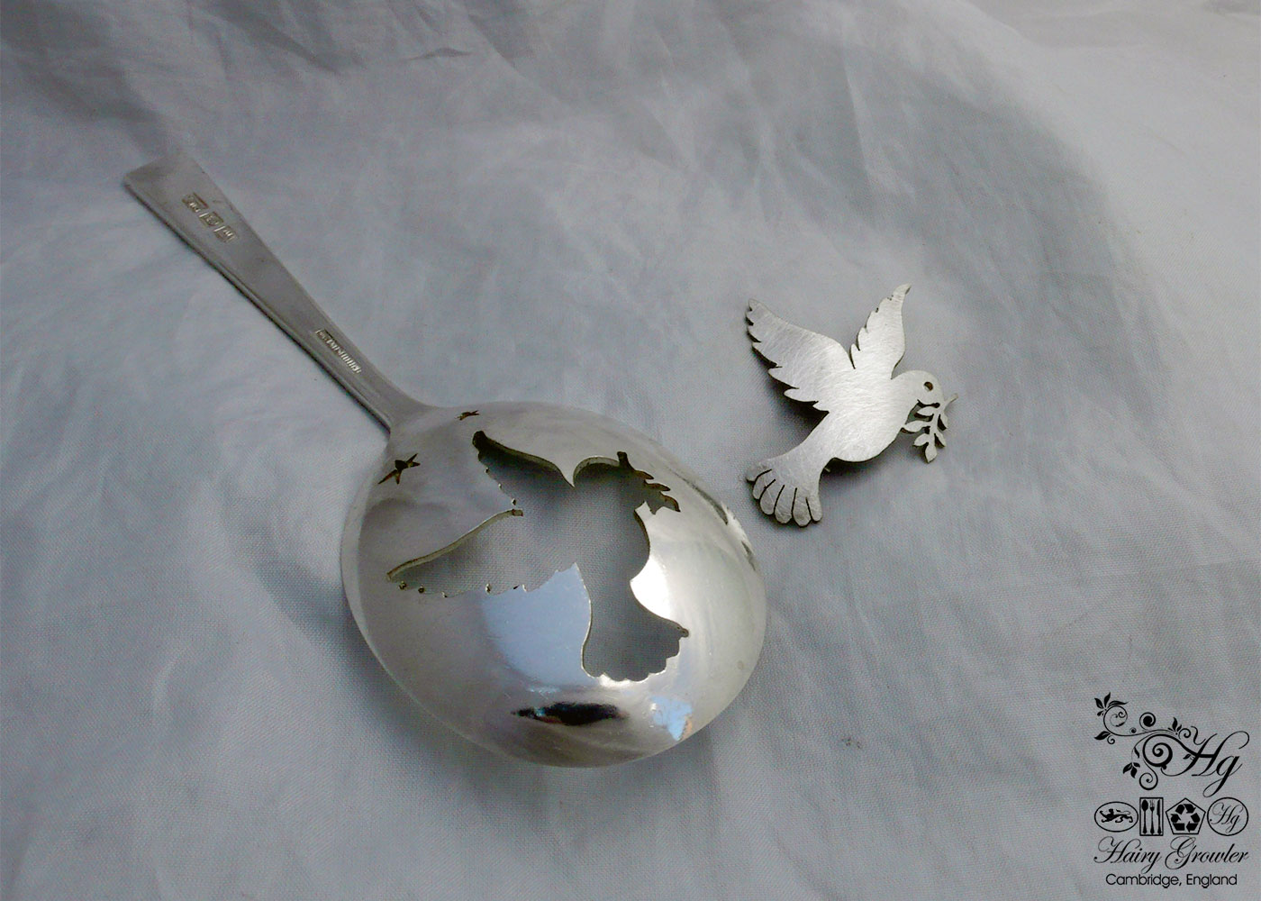 handcrafted and recycled peace dove spoon brooch