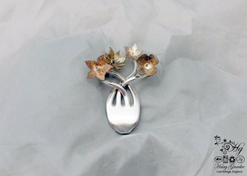 handcrafted and recycled fork flower brooch