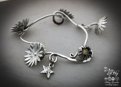 Daisy chain bracelet handcrafted and recycled from an old Victorian silver coins