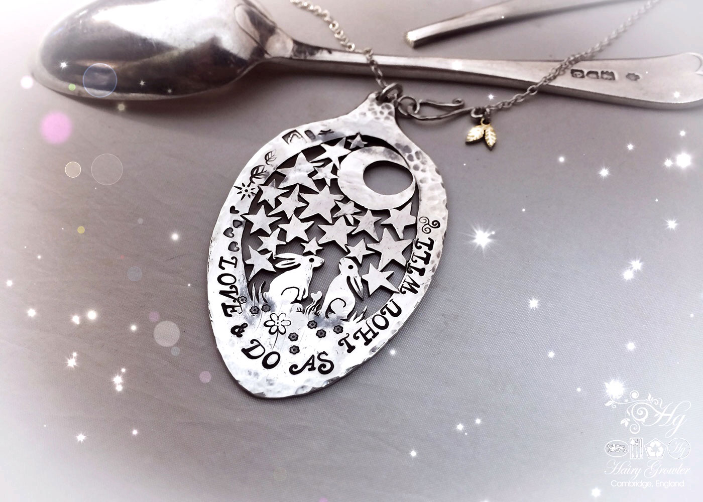 Handcrafted and recycled Victorian silver spoon moon gazing hares necklace made in Cambridge