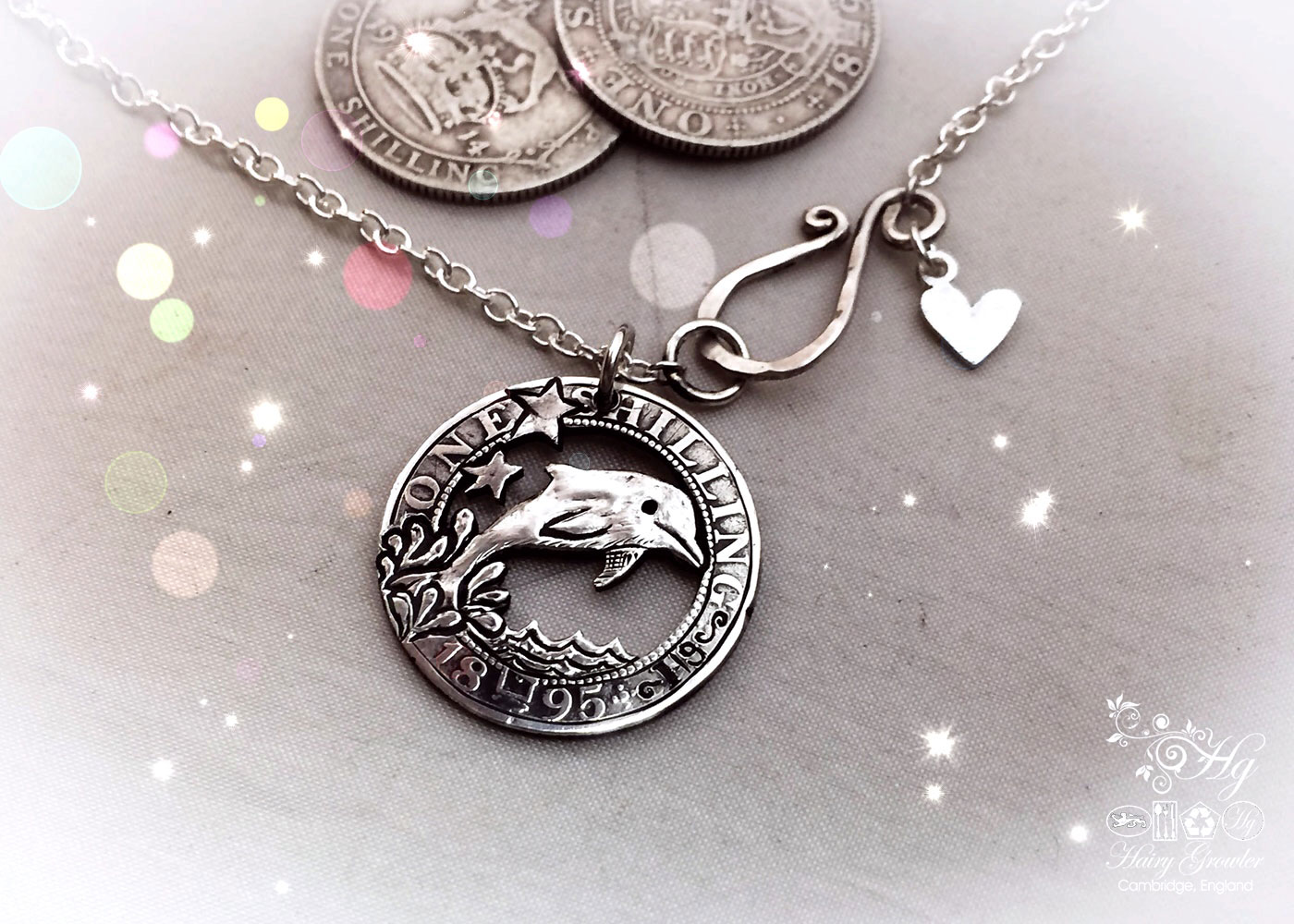 handmade and upcycled silver shilling dolphin necklace