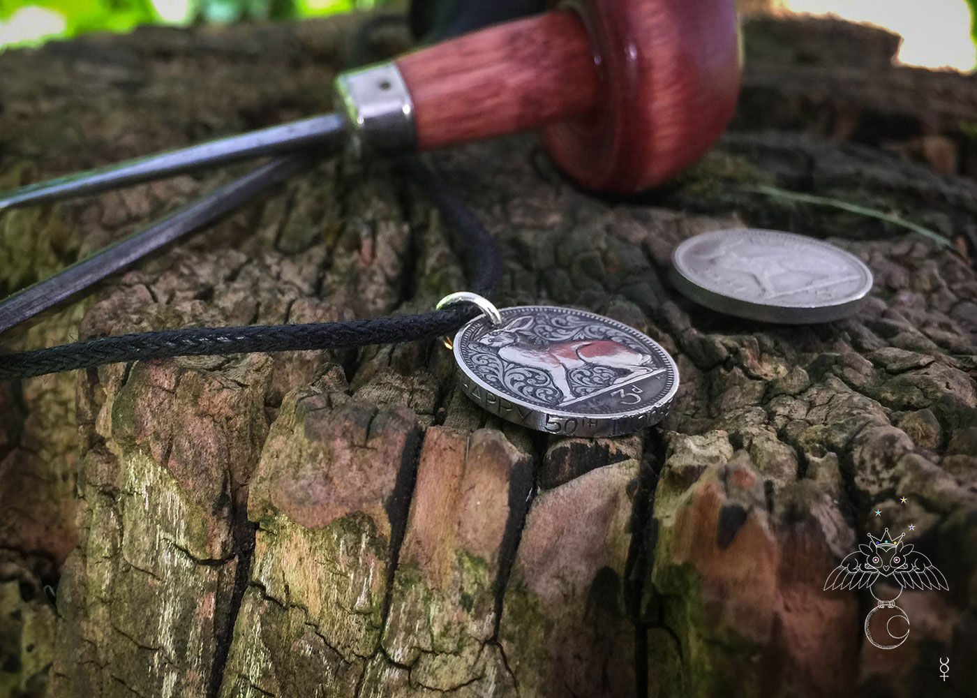 hand carved flourish Irish hare threepence coin pendant with hand carved massage on the edge