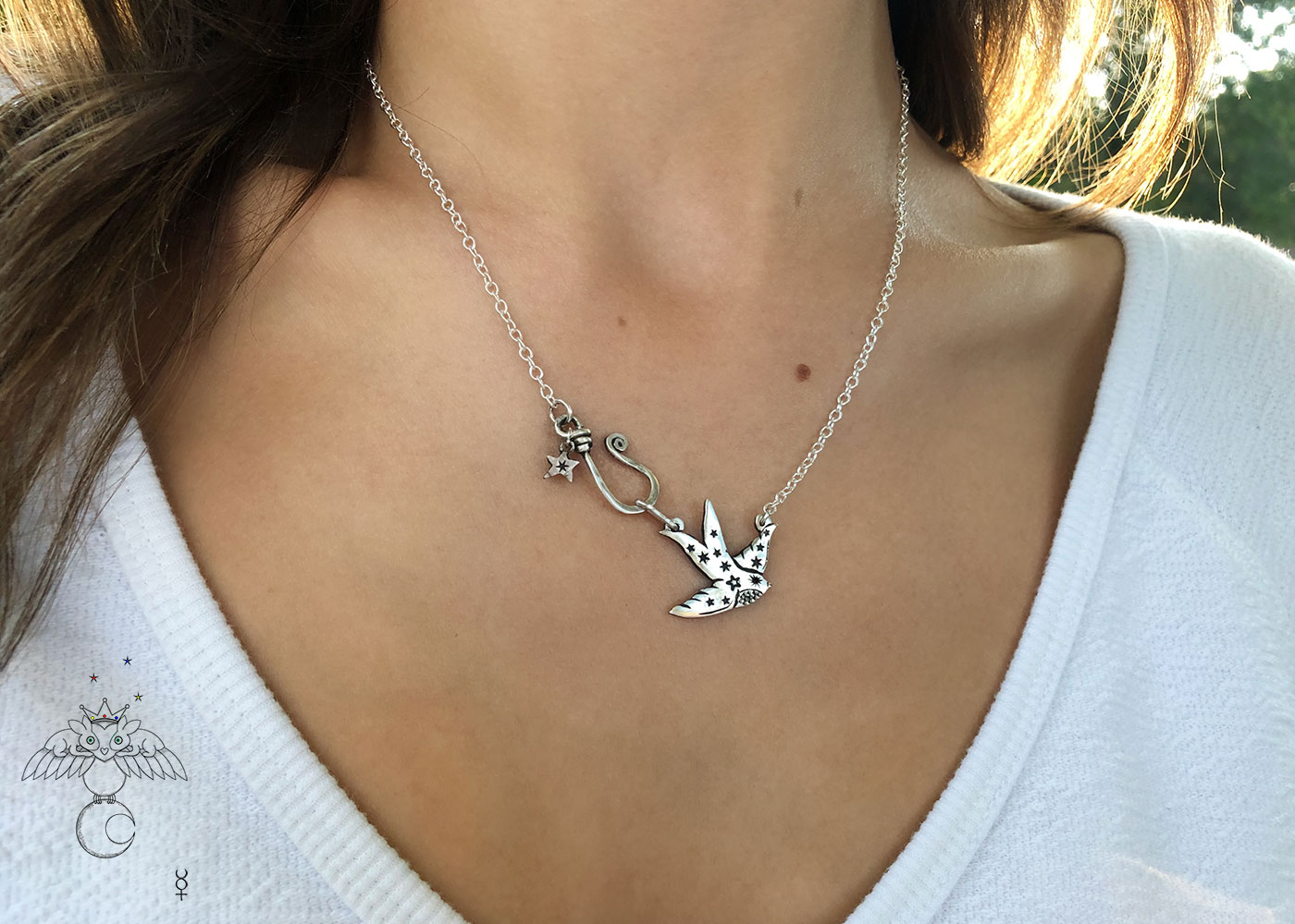 Swallow necklace handcrafted and recycled coin jewellery made from a silver Florin coin. Ethical jewellery made in an artisan workshop