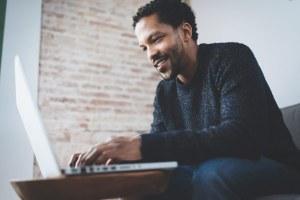 male using his laptop - male-using-his-laptop