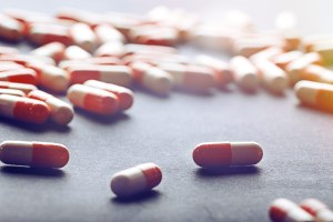 pharmaceuticals and medicine on a table - pharmaceuticals-and-medicine-on-a-table