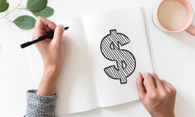 Notebook mit einem Dollarzeichen