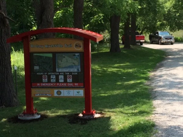 Rotary Riverside Trail Signage stands beside the trail, providing visitors with information they need to enjoy their hike