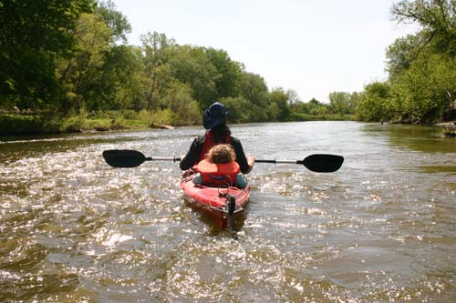 A Father and son enjoy their weekend together, kayaking along the mighty Grand River