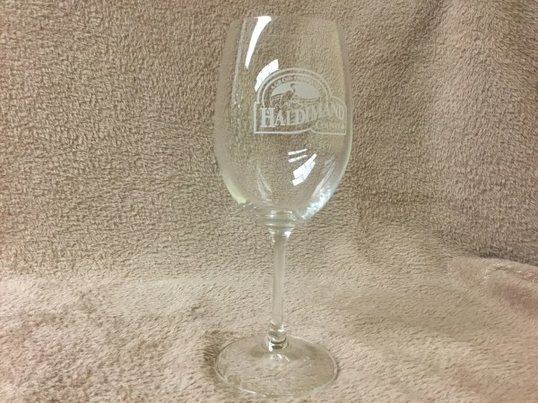 Clear wine glass etched with Haldimand County Logo