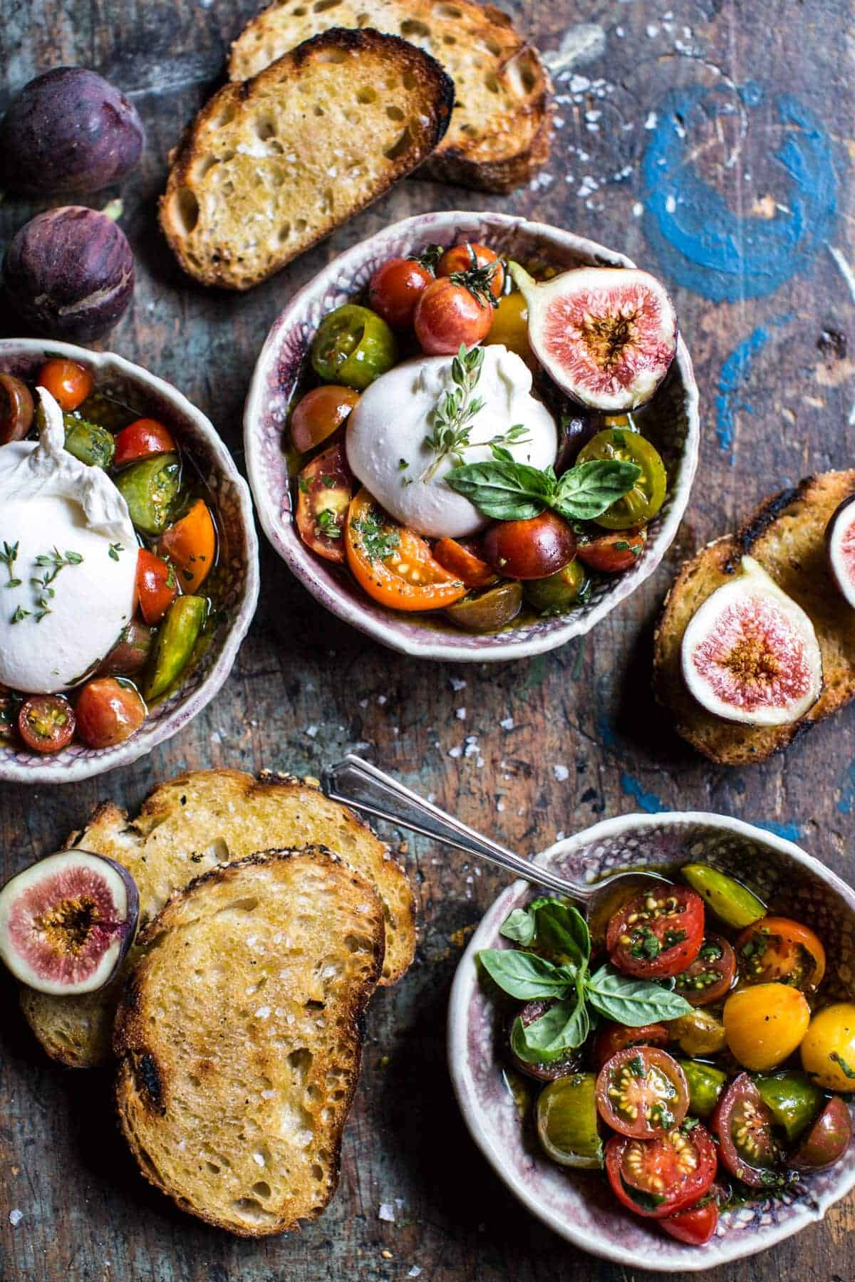 marinated cherry tomatoes with burrata and toast