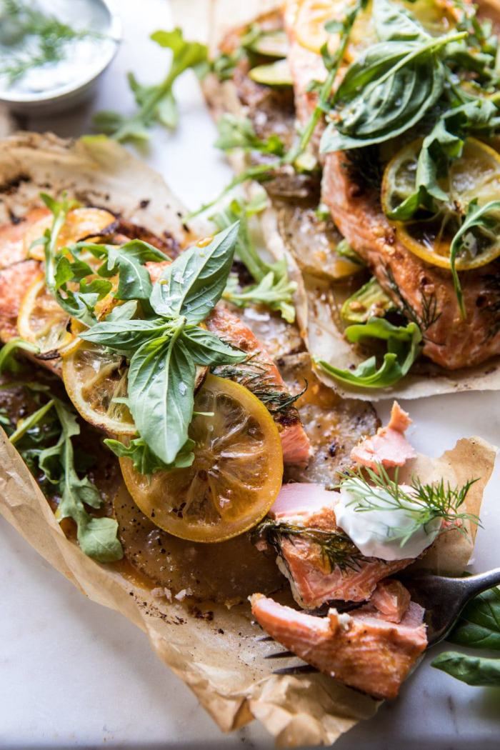 side angle photo of cut into Parchment Baked Lemon Salmon and Potatoes with Dill Yogurt
