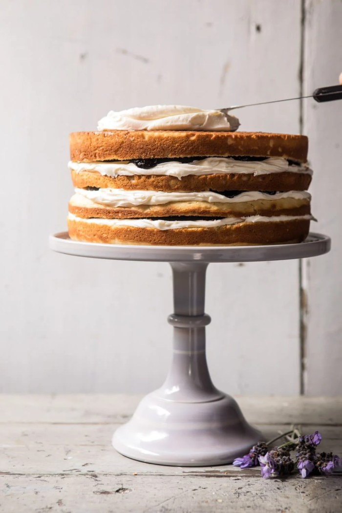 photo of unfrosted Blackberry Lavender Naked Cake with White Chocolate Buttercream