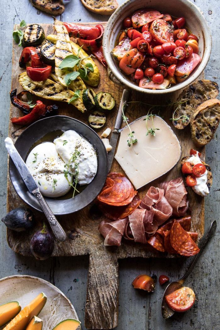 overhead photo of Marinated Tomato and Grilled Veggie Cheese Board with tomatoes on toast