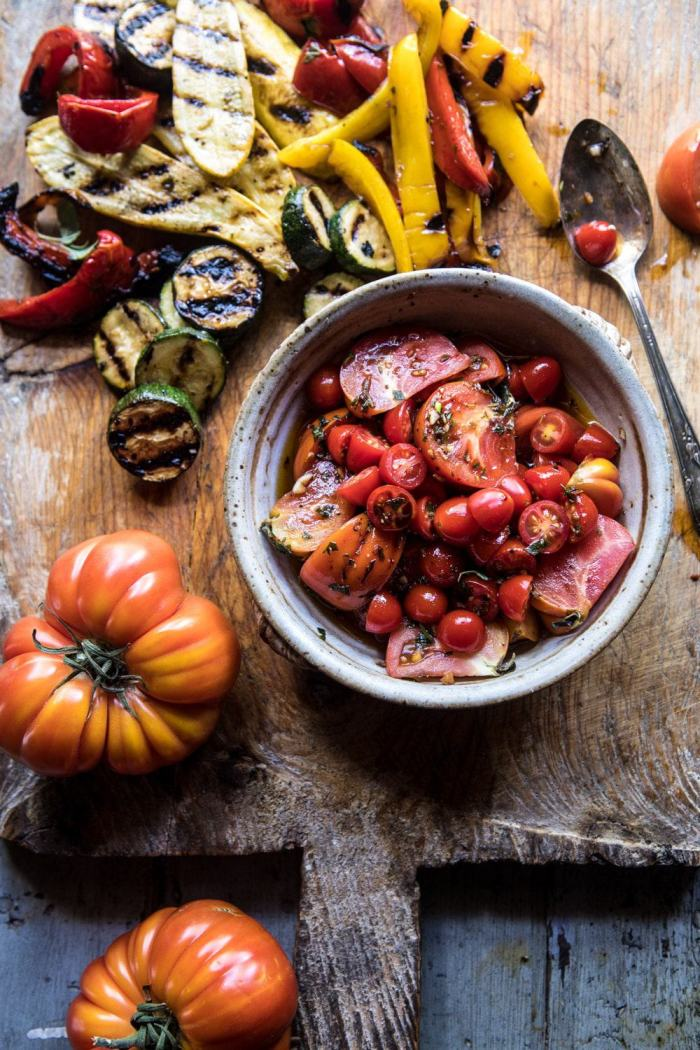 overhead photo of Marinated Tomatoes and Grilled Vegetables on cutting board