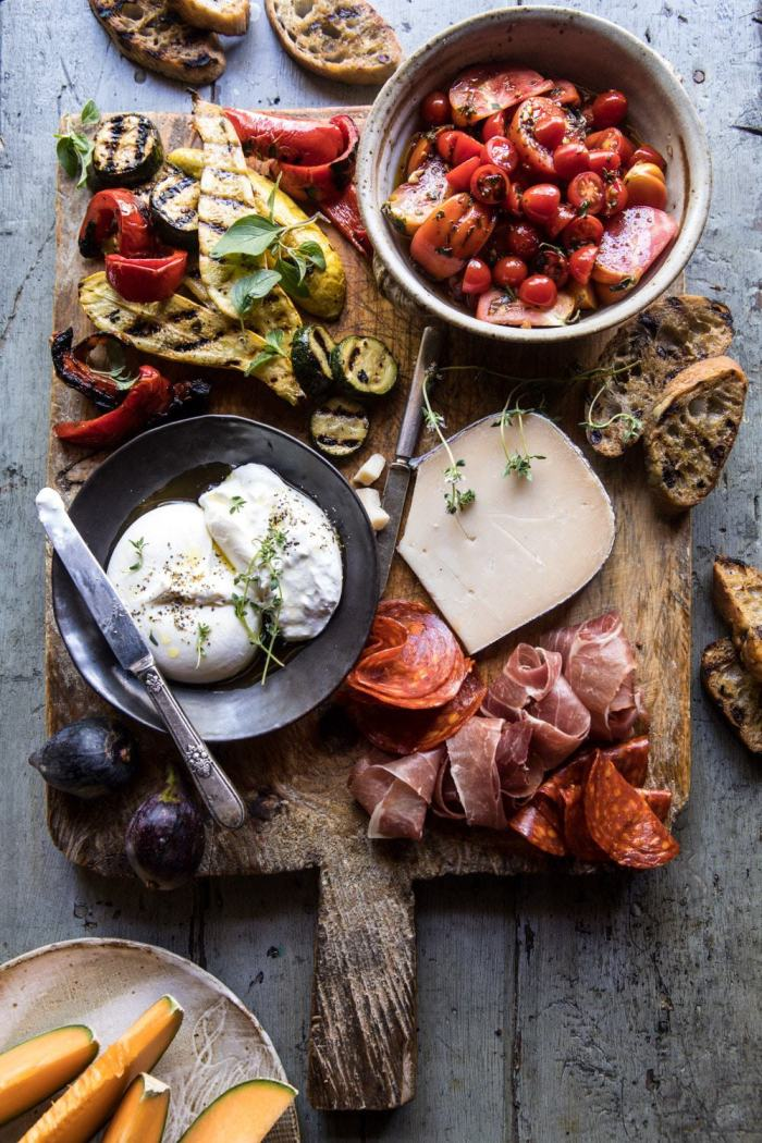 overhead photo of Marinated Tomato and Grilled Veggie Cheese Board