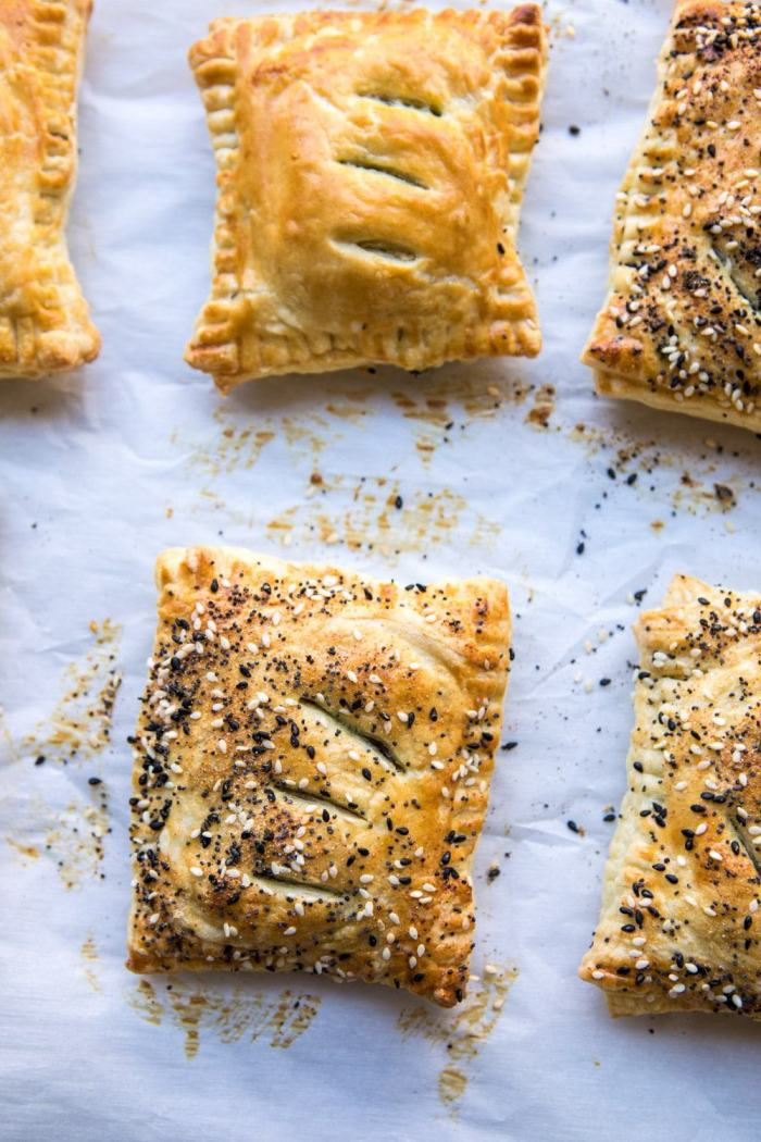 Caramelized Onion, Spinach, and Cheddar Flaky Pastries on baking sheet after baking