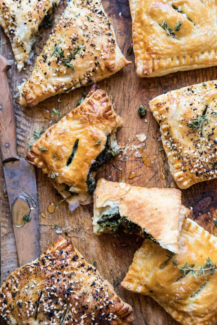 overhead photo of broken Caramelized Onion, Spinach, and Cheddar Flaky Pastry