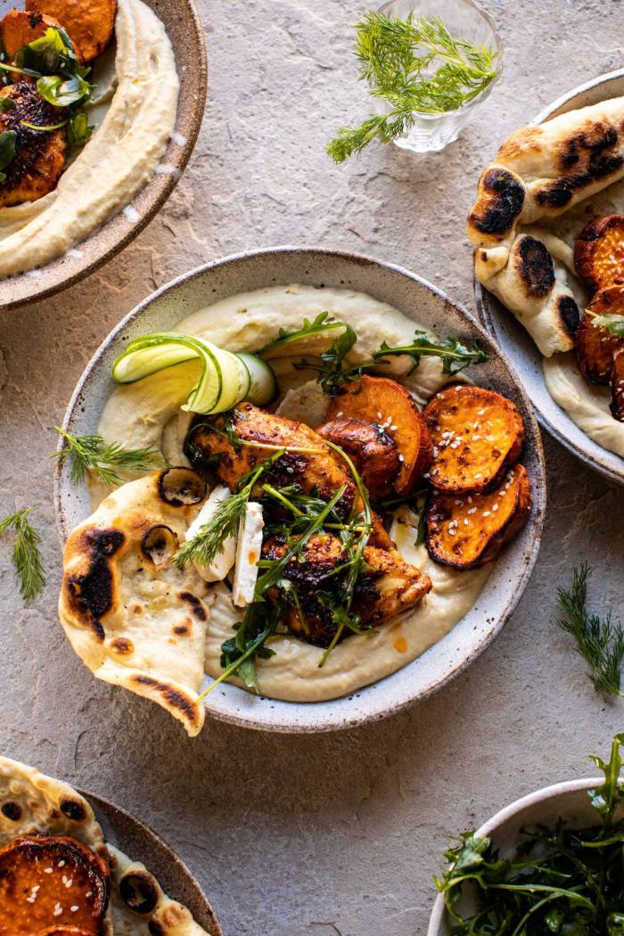 overhead photo of Sheet Pan Chicken Shawarma with Sesame Sweet Potatoes and Hummus in a bowl