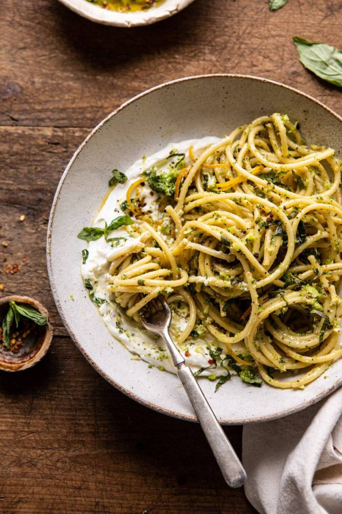 overhead close up photo of Broccoli Pesto Pasta with Whipped Ricotta and fork in bowl