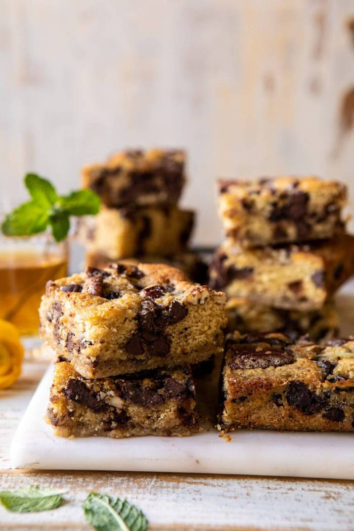 side angled photo of Kentucky Derby Pie Chocolate Chip Cookie Bars stacked on top of each other
