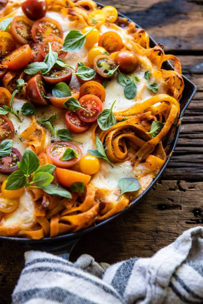 side angled close up photo of One Pot 30 Minute Creamy Tomato Basil Pasta Bake in skillet