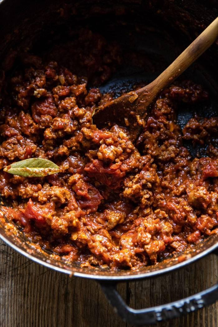 overhead photo of ragu sauce in pot