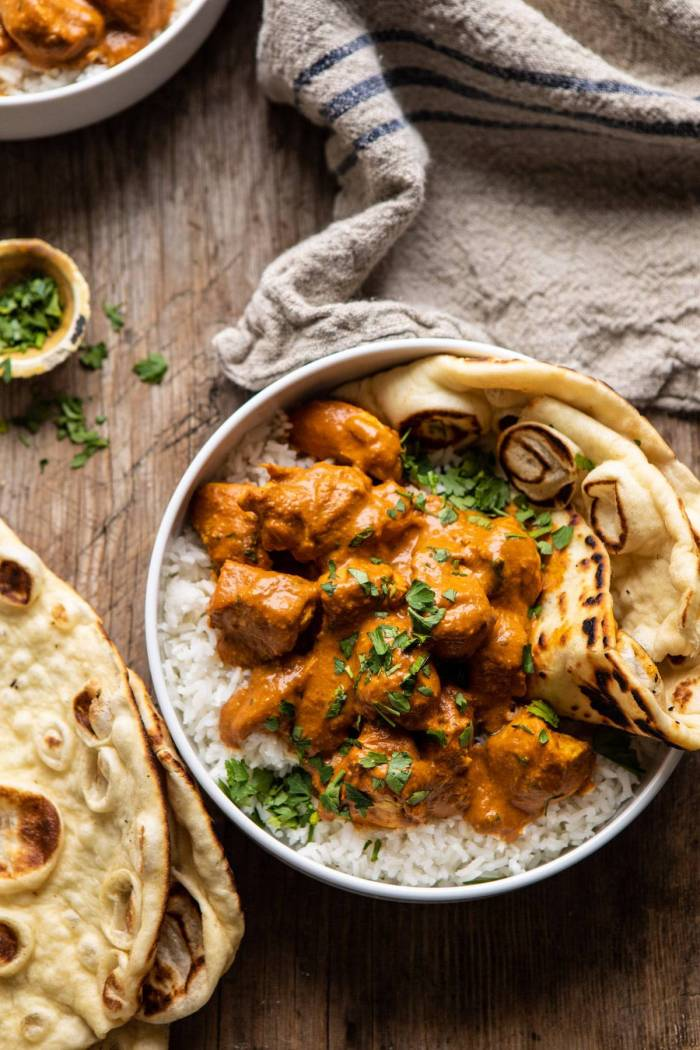 overhead photo of Super Simple Coconut Chicken Tikka Masala with towel in photo