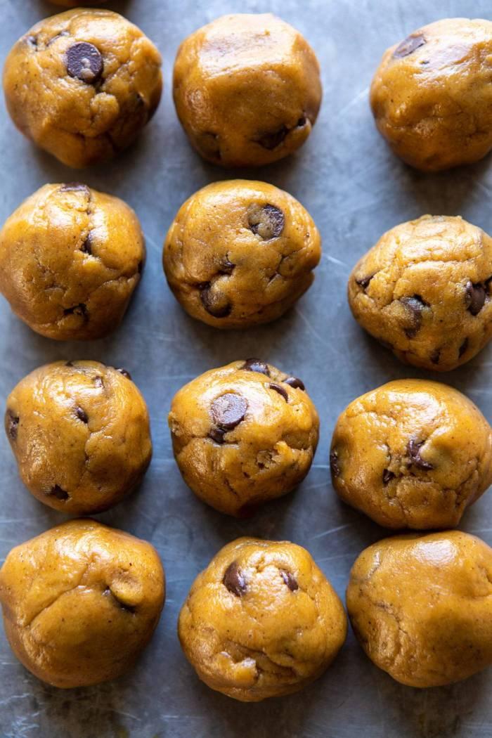 overhead photo of Pumpkin Butter Chocolate Chip Cookie dough balls on baking sheet