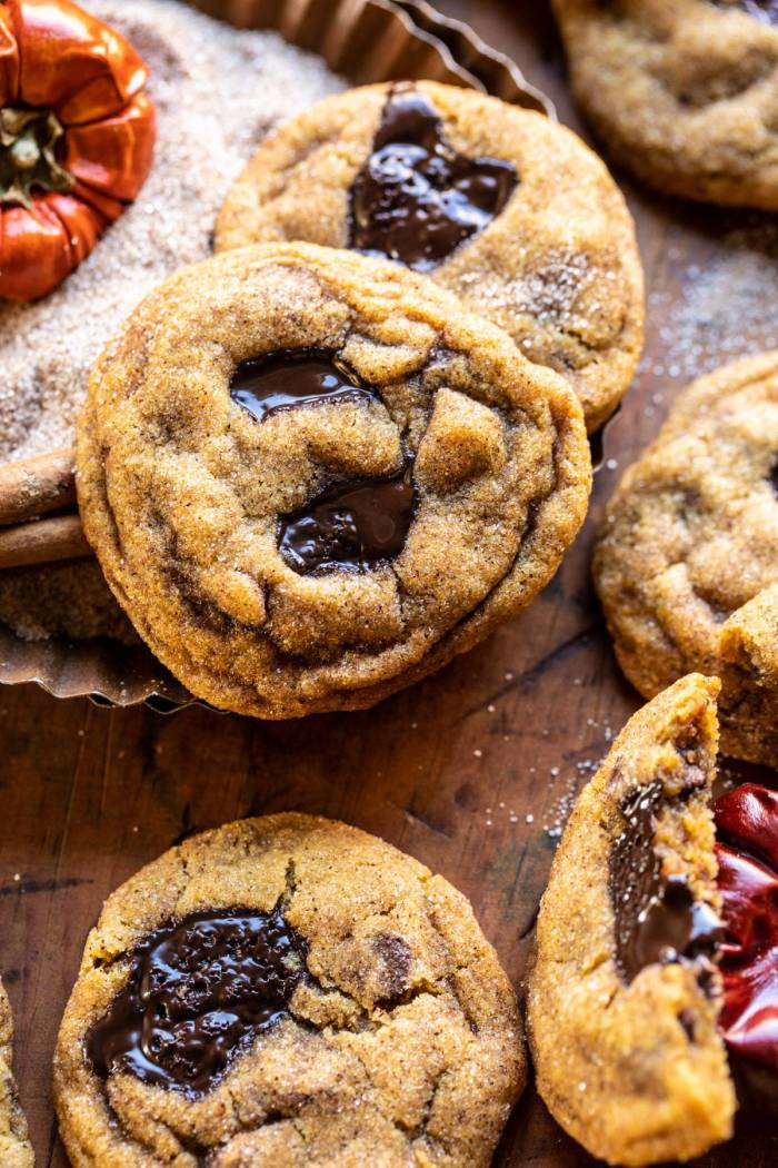 side angle close up photo of Pumpkin Butter Chocolate Chip Cookies with broken cooking in the right hand corner