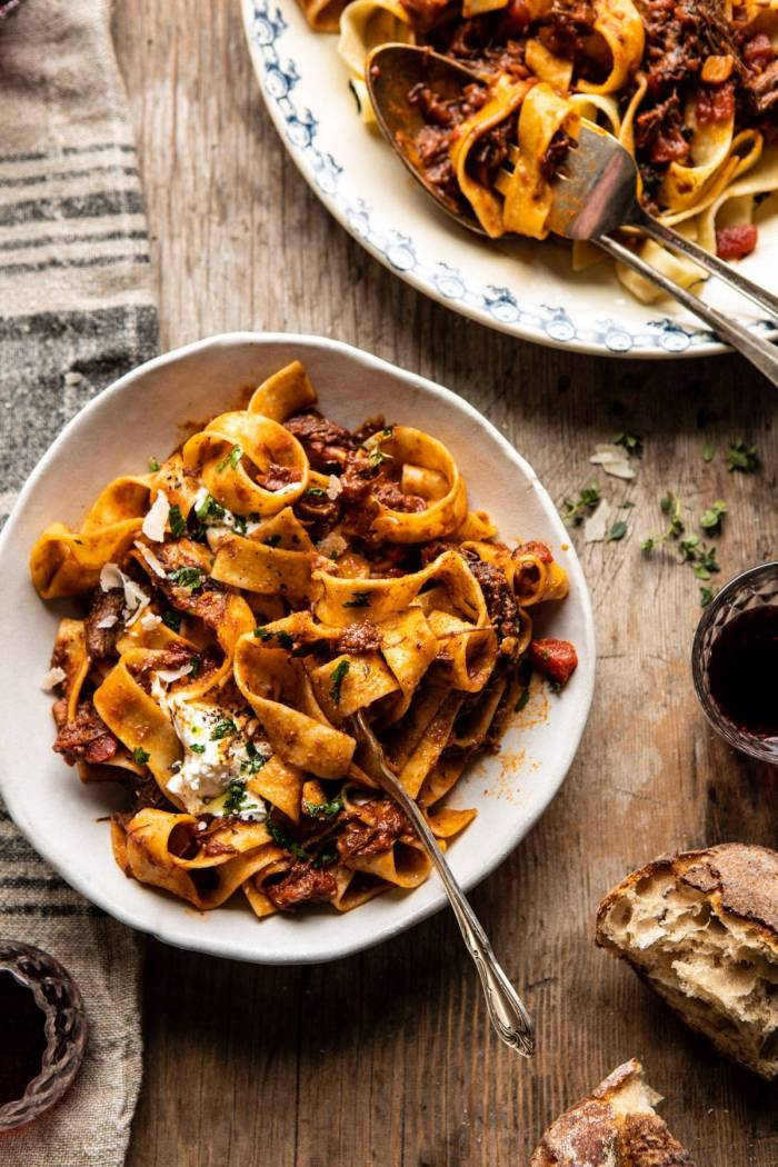 overhead photo of Slow Cooker Red Wine Sunday Ragu Pasta with fork in pasta