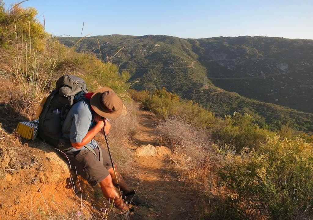 Tired Hiker Sitting
