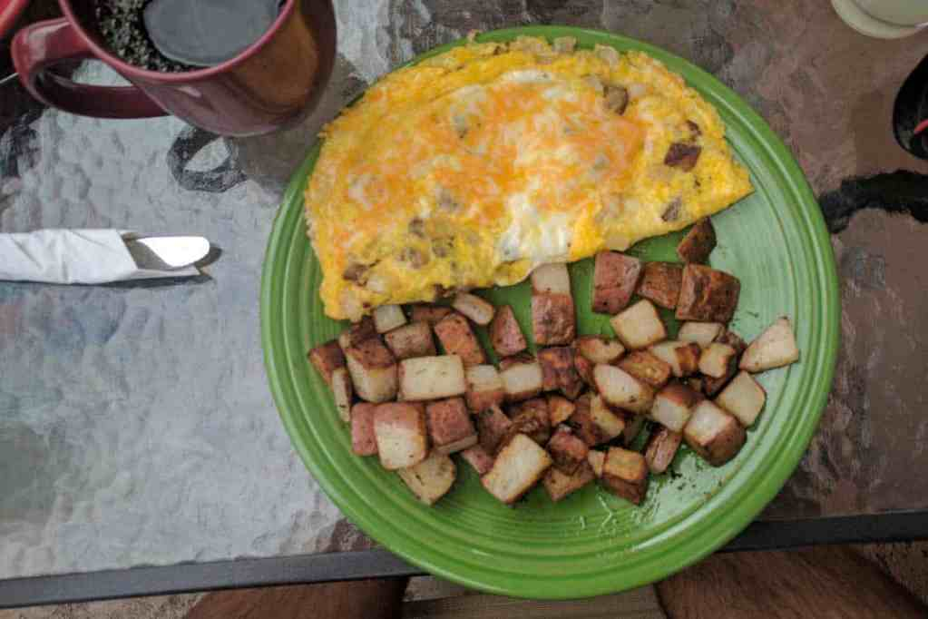 An omelette and breakfast potatoes - not a great resupply, but an excellent town meal.