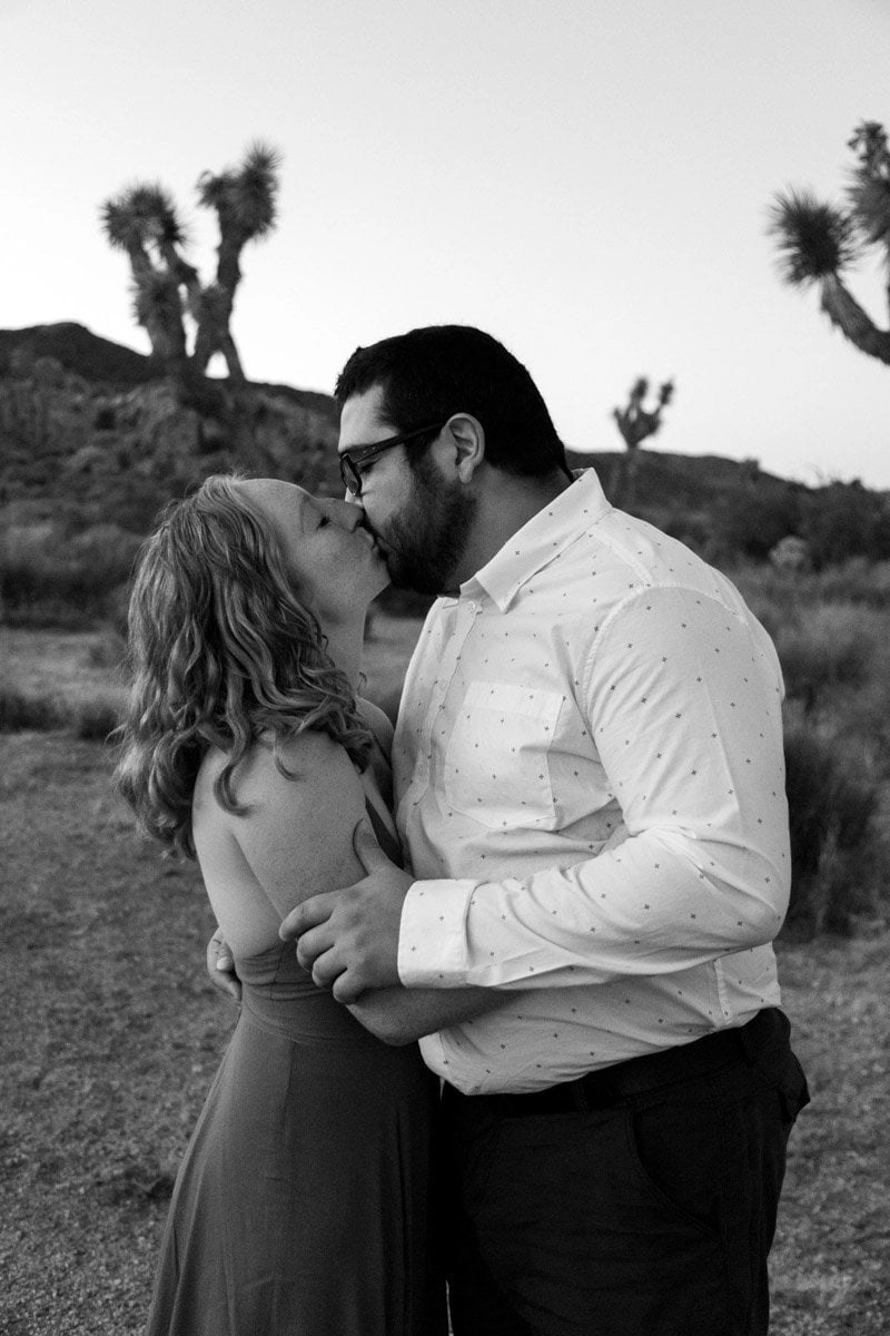 lovers kissing in black and white