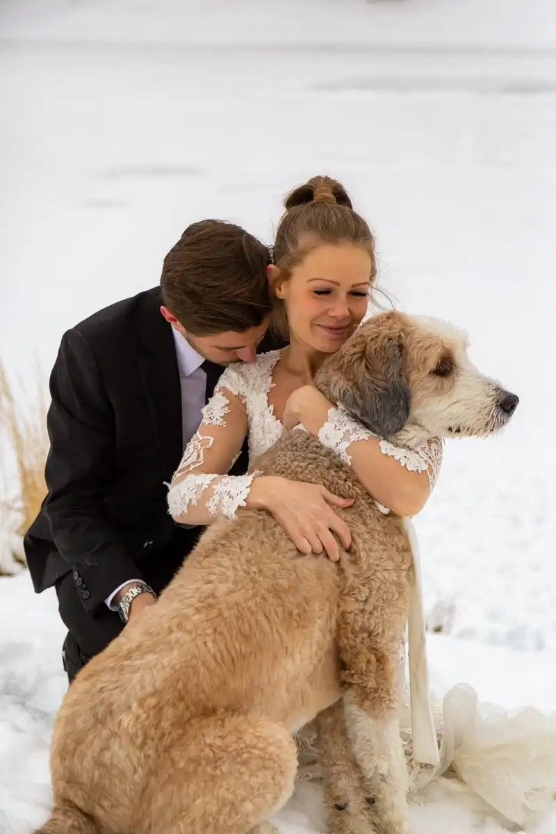 elopement couple hugging their pup